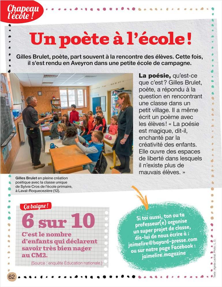 Gilles Brulet en pleine création poétique avec la classe unique de Sylvie Cros de l'école primaire, à Laval-Roquecezière (12). Photo : L. D. - J'aime lire n°489, octobre 2017.